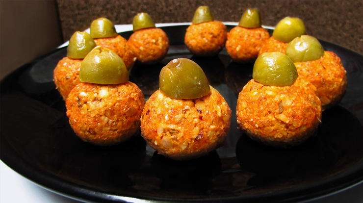 Salty and savory raw walnut balls with olives