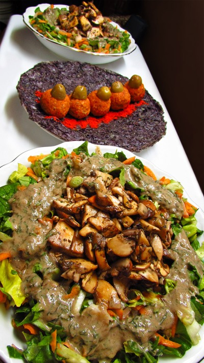 Lettuce and marinated mushroom salad with salty walnut balls