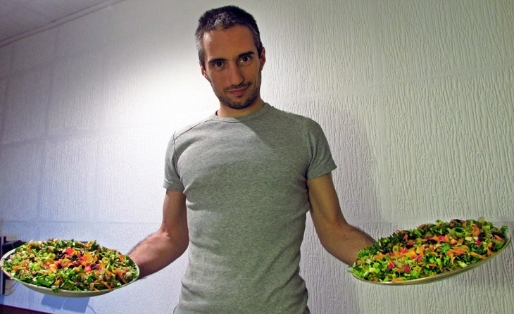 Mladen holding two raw pizzas